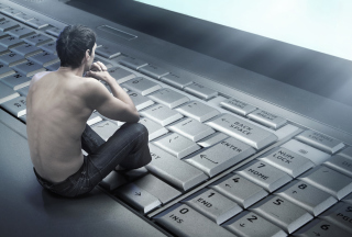 Man Sitting On Keyboard Picture for Android, iPhone and iPad
