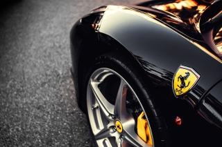 Black Ferrari With Yellow Emblem Wallpaper for Android, iPhone and iPad