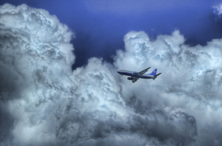 Airplane In Clouds Picture for Android, iPhone and iPad