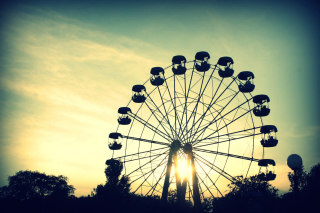 Free Sunlight Through Ferris Wheel Picture for Android, iPhone and iPad