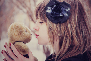Girl Kissing Teddy Bear Picture for Android, iPhone and iPad