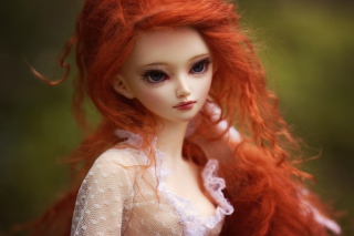 Gorgeous Redhead Doll With Sad Eyes Picture for Android, iPhone and iPad