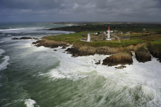 Lighthouse On Hill And Big Waves Picture for Android, iPhone and iPad