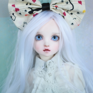 Blonde Doll With Big Bow - Obrázkek zdarma pro iPad