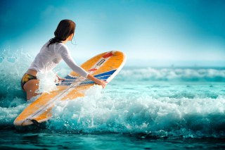 Free Surfing Girl Picture for Android, iPhone and iPad