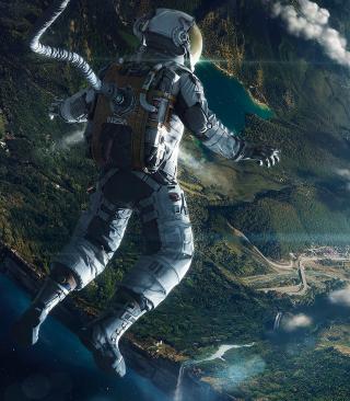 Astronaut In Space - Obrázkek zdarma pro Nokia Asha 203