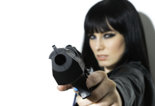 Free Brunette With Gun Picture for Android, iPhone and iPad