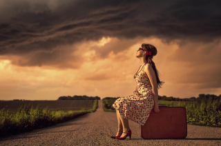 Free Girl Sitting On Luggage On Road Picture for Android, iPhone and iPad