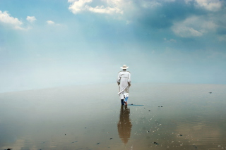 Man In White Hat Walking On Water Picture for Android, iPhone and iPad