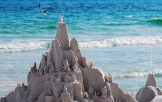 Sandcastles On Beach Background for Android, iPhone and iPad
