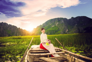 Free Beautiful Asian Girl With Flowers Bouquet Sitting In Boat Picture for Android, iPhone and iPad