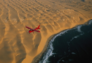 Free Airplane Above Desert Picture for Android, iPhone and iPad