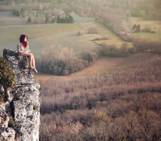 Redhead Girl Sitting On Rock - Obrázkek zdarma pro iPad