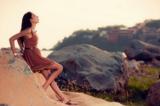 Brunette Girl Posing On Rocks Wallpaper for Android, iPhone and iPad