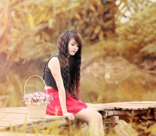 Sad Asian Girl With Flower Basket - Obrázkek zdarma pro 208x208