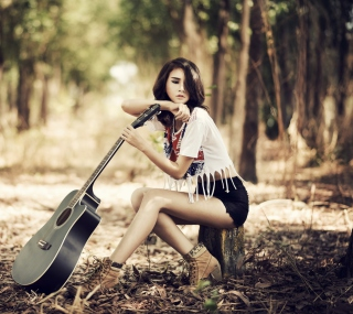 Pretty Brunette Model With Guitar At Meadow - Obrázkek zdarma pro iPad Air
