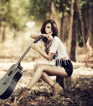 Pretty Brunette Model With Guitar At Meadow - Obrázkek zdarma pro 640x960