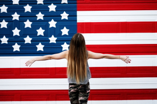 Free American Girl In Front Of USA Flag Picture for Android, iPhone and iPad