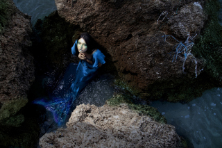 Blue Mermaid Hiding Behind Rocks Picture for Android, iPhone and iPad